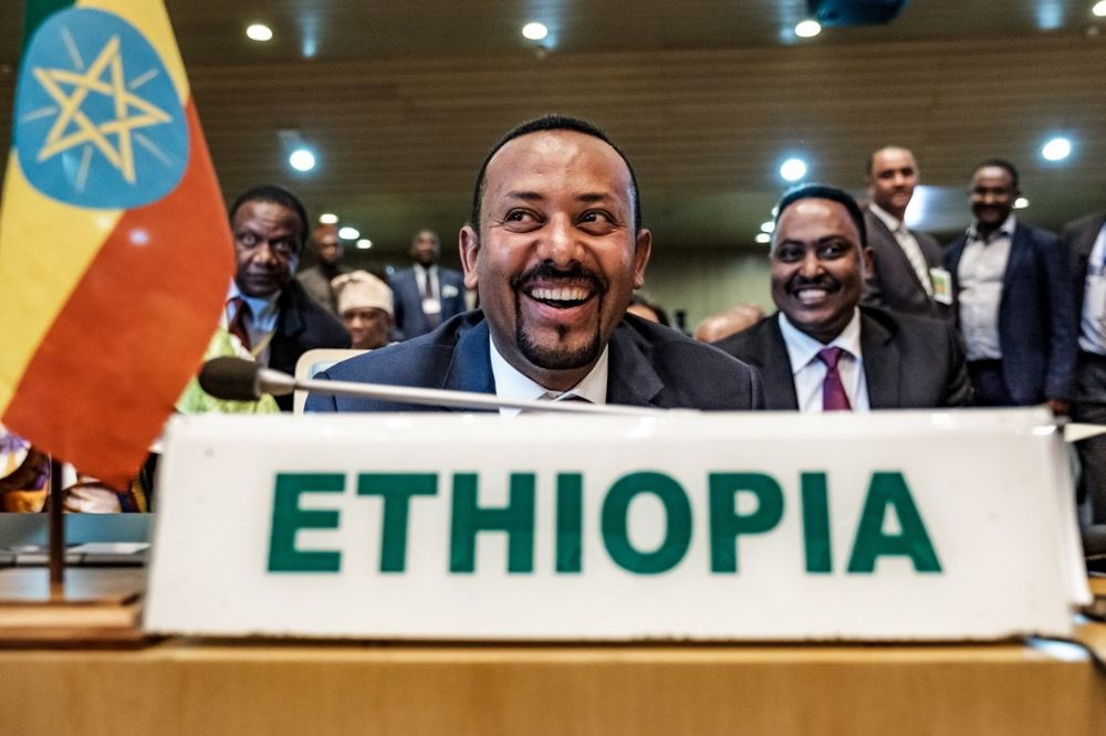 Ethiopia's Prime Minister Abiy Ahmed (centre) smiles before a High Level Consultation Meeting with African leaders on DR Congo election at AU headquarters in Addis Ababa, January 17, 2019. — AFP pic
