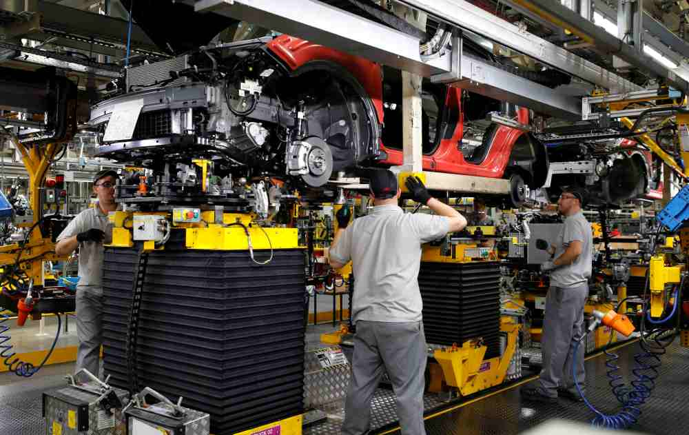 Workers are seen on the production line at Nissan's car plant in Sunderland, Britain October 10, 2019. ― Reuters file pic