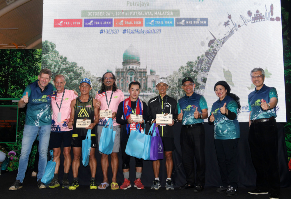 Tourism, Arts and Culture Ministry deputy secretary-general (tourism) Datuk Haslina Abdul Hamid (2nd right) with winners of the EcoTrail 80km men's open category at the Visit Malaysia Year soft launch campaign for Putrajaya level and closing ceremony for EcoTrail Putrajaya 2019 in Putrajaya October 26, 2019. — Bernama pic