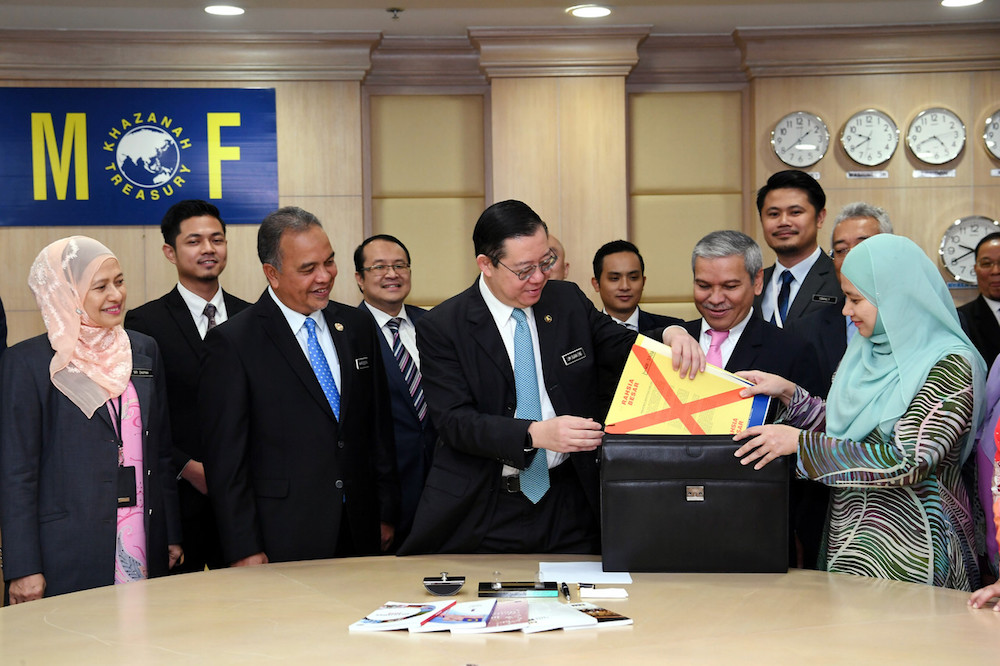 Finance Minister Lim Guan Eng places his Budget 2020 speech into a briefcase at the Finance Ministry in Putrajaya October 10, 2019. — Bernama pic