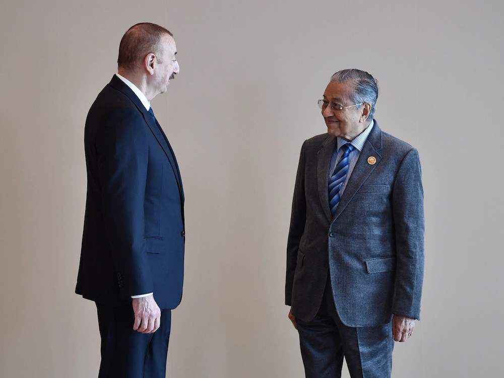 Prime Minister Tun Dr Mahathir Mohamad talks to Azerbaijan President Ilham Aliyev at the Baku Congress Centre, Baku October 25, 2019, where they are attending the opening ceremony of the 18th Non-Aligned Movement (NAM) Summit. — Bernama pic