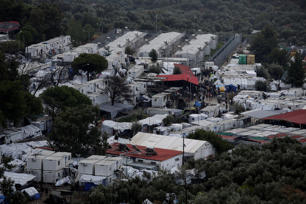 Refugees and migrants are seen inside the Moria camp on the island of Lesbos, Greece, October 8, 2019. — Reuters pic