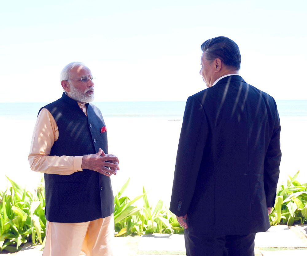 India's Prime Minister Narendra Modi and China's President Xi Jinping talk during their meeting in Mamallapuram on the outskirts of Chennai, India, October 12, 2019. —  Indias Press Information Bureau handout pic via Reuters