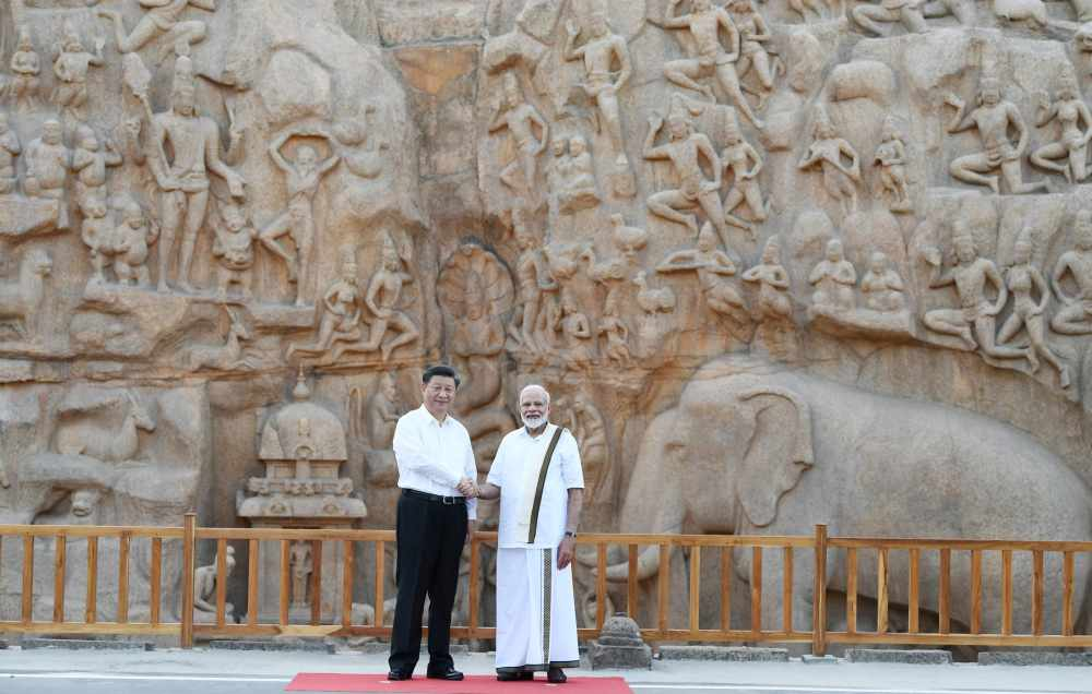 China's President Xi Jinping shakes hands with India's Prime Minister Narendra Modi during their visit to Arjuna's Penance in Mamallapuram on the outskirts of Chennai, India October 11, 2019. ― Handout via Reuters