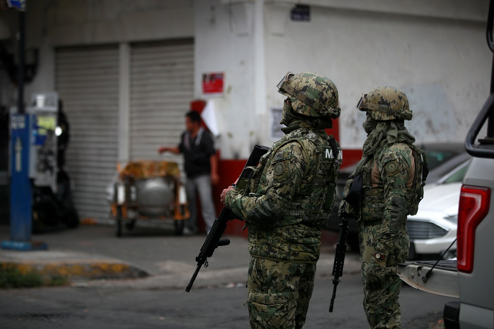 Mexican Marines keep watch during a raid on a warren of clandestine tunnels and alleged drug laboratories at Tepito neighbourhood in downtown Mexico City, Mexico October 22, 2019. — Reuters pic