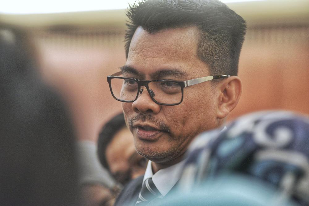Deputy Home Minister Datuk Mohd Azis Jamman said the granting of Malaysian citizenship was subject to the provisions of the Federal Constitution. ― Picture by Ahmad Zamzahuri