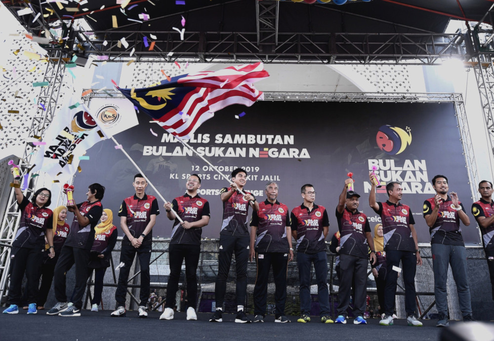 Youth and Sports Minister Syed Saddiq Syed Abdul Rahman, his deputy Steven Sim Chee Keong (4th left) during the launch of National Sports Day at the Bukit Jalil National Stadium October 12, 2019. — Bernama pic