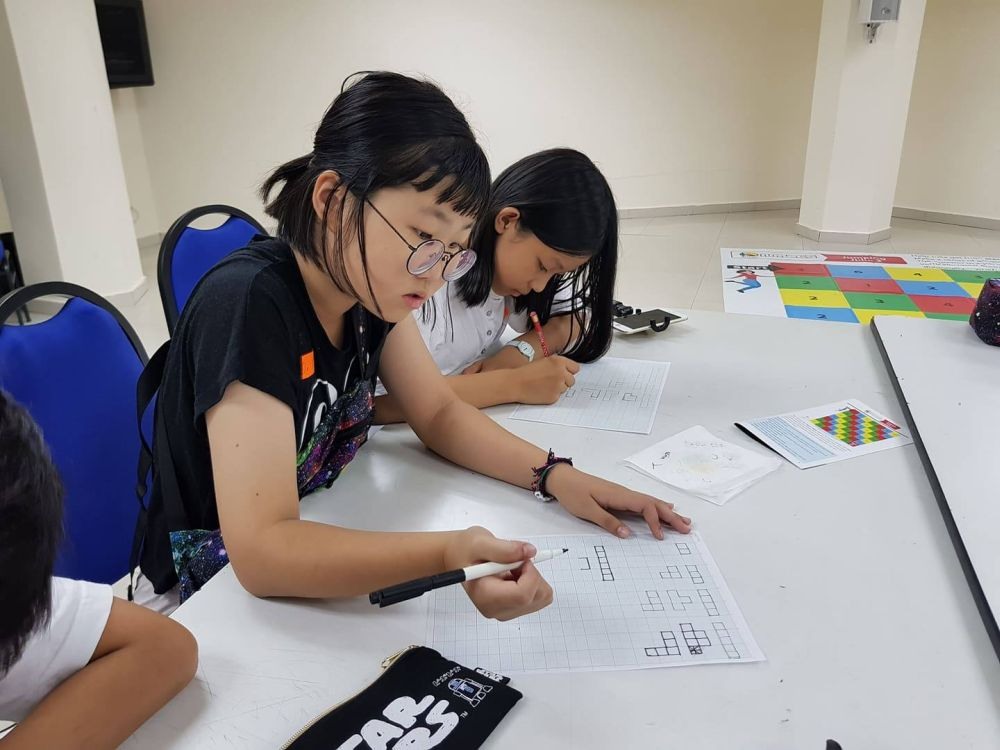 Some of the child participants at the Youth Festival working together to complete complex puzzles. — Picture courtesy of Malaysian Mensa Society