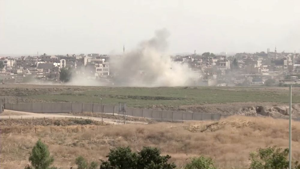 Smoke billows out after Turkish shelling on the Syrian border towns of Qamishli and Ras Al Ain, as seen from Nusaybin, Turkey, October 11, 2019 in this still image taken from a video. — ReutersTV pic