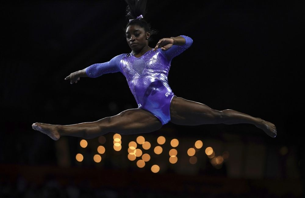 USA's Simone Biles performs on the beam during the apparatus finals at the FIG Artistic Gymnastics World Championships at the Hanns-Martin-Schleyer-Halle in Stuttgart, Germany, October 13, 2019. — AFP pic