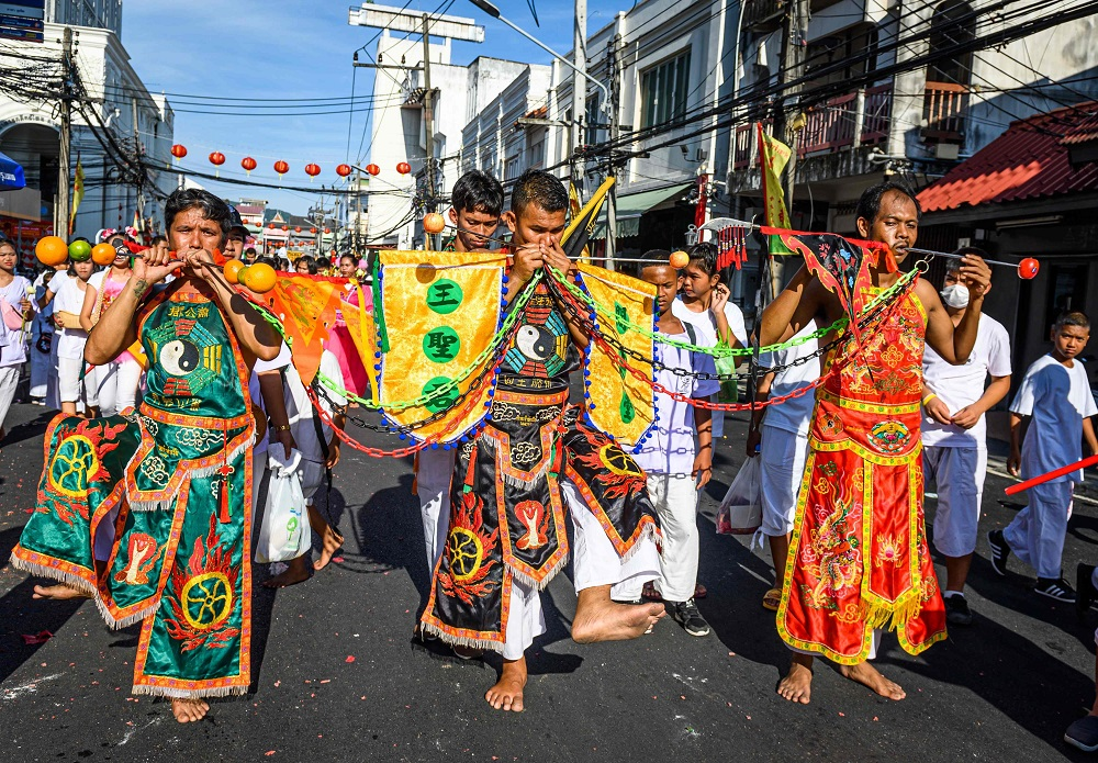 Devotees of a Chinese shrine with skewers pierced through their cheeks take part in a procession during the annual Vegetarian Festival in Phuket October 3, 2019. — AFP pic