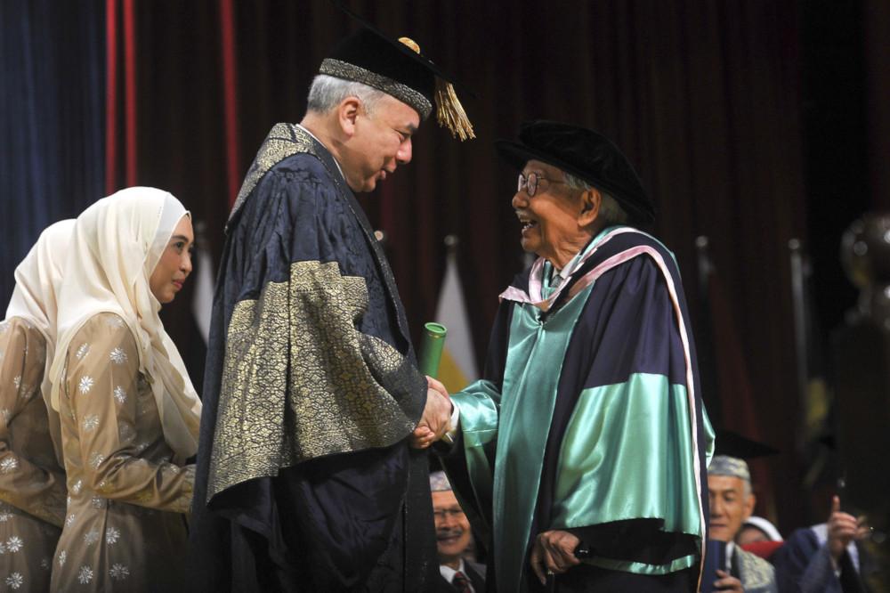 Tun Daim Zainuddin receives his PhD scroll from Universiti Malaya Chancellor Sultan Nazrin Shah at the university's 58th convocation ceremony at Dewan Tunku Canselor in Kuala Lumpur October 12, 2019. — Bernama pic