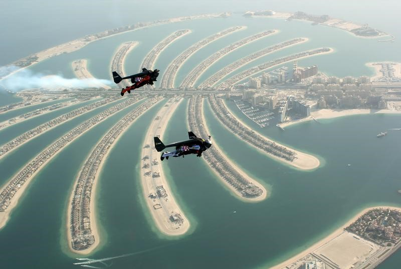 An aerial view taken from a sea plane shows Swiss pilot and original Jetman Yves Rossy (front) and Vince Reffett flying over Dubai's Palm Island, Dubai, United Arab Emirates May 12, 2015. — Reuters pic