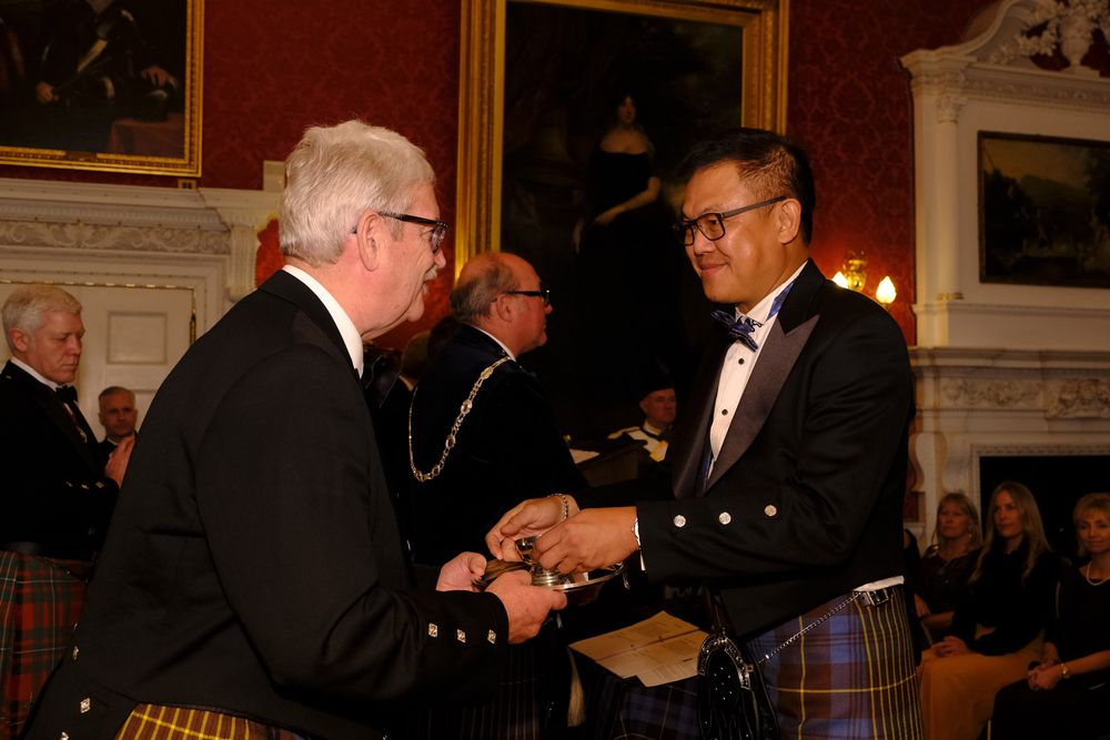 Soh receiving his Quaich from a patron of the 'Keeper of the Quaich' society.