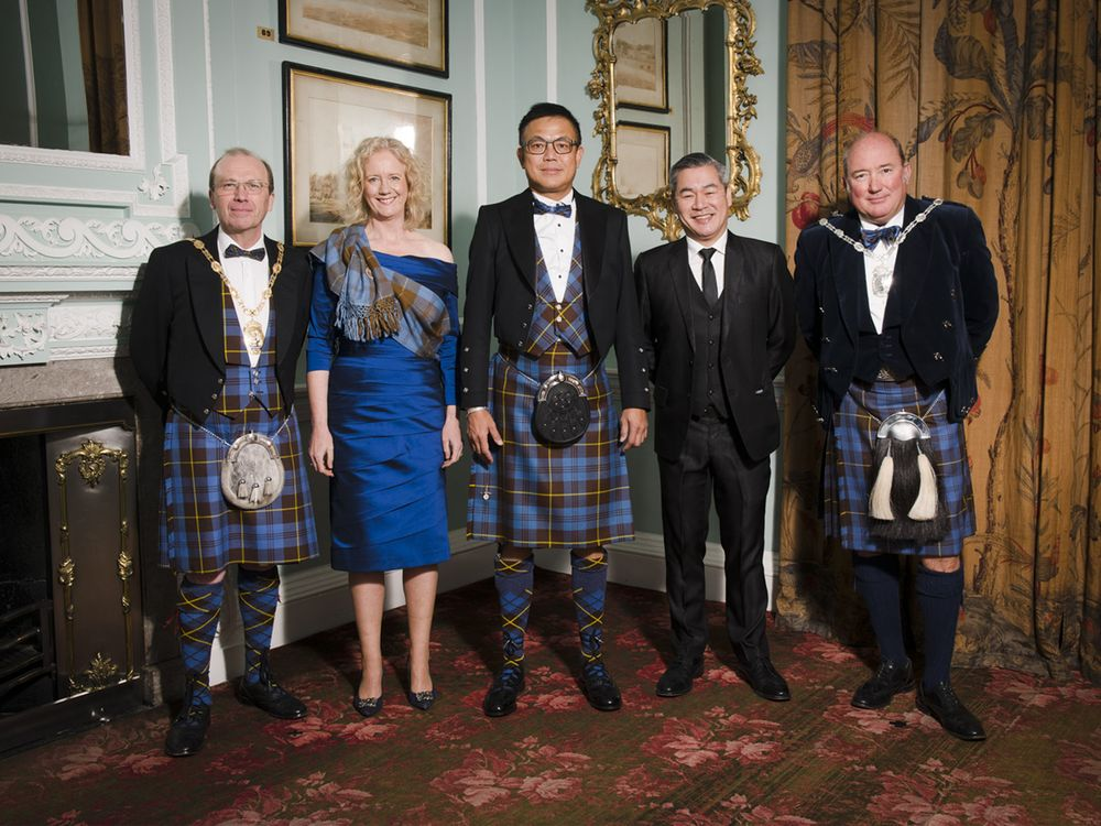 Soh poses for a picture with the patrons of the 'Keeper of the Quaich' society at Blair Castle.