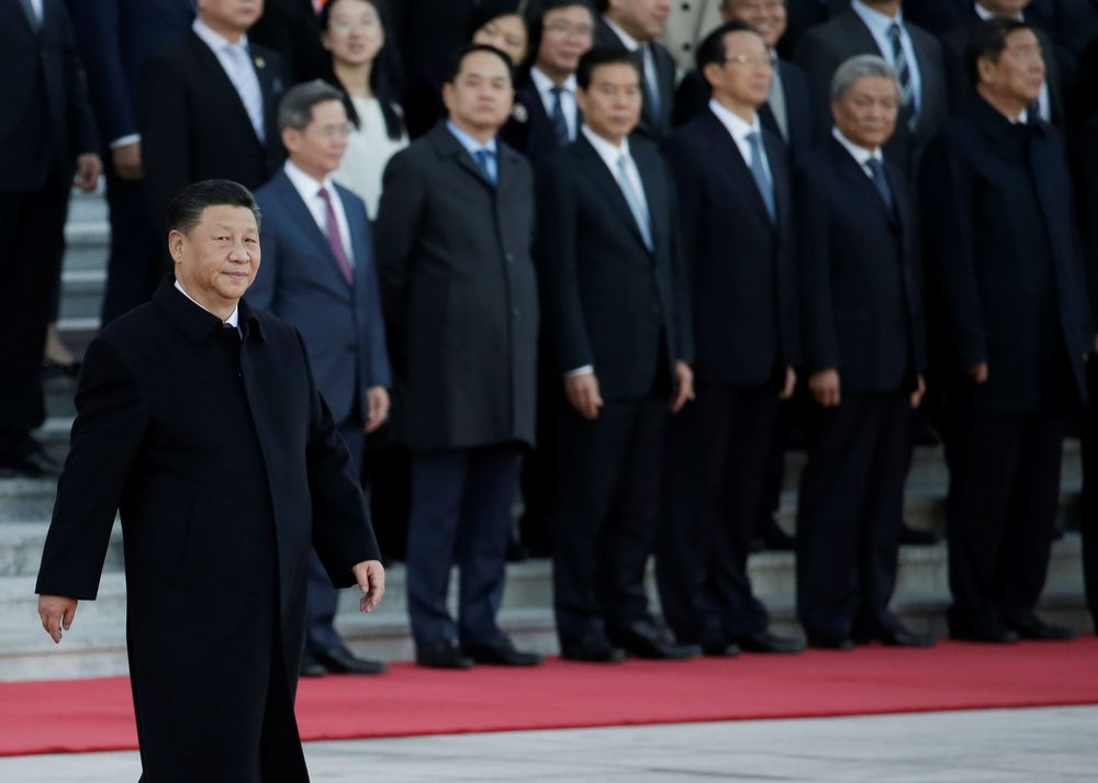 Chinese President Xi Jinping walks past senior officials during a welcoming ceremony at the Great Hall of the People in Beijing, October 25, 2019. — Reuters pic