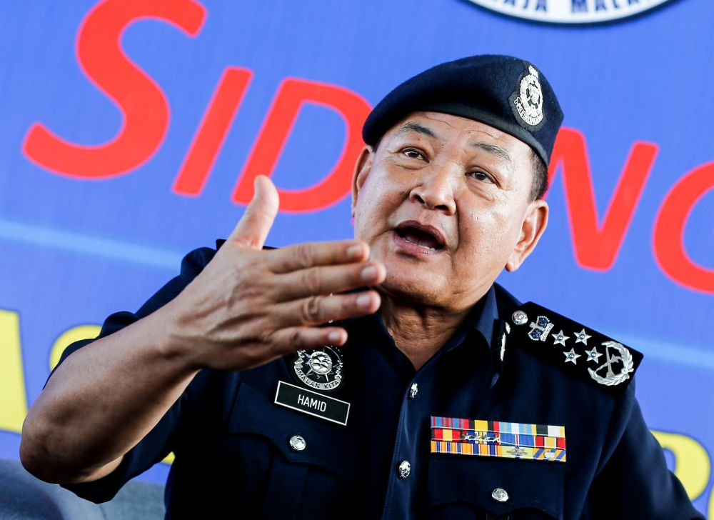 Inspector-General of Police Tan Sri Abdul Hamid Bador speaks to reporters during a media conference at the Marine Police Base in Batu Uban, George Town October 10, 2019. — Picture by Sayuti Zainudin