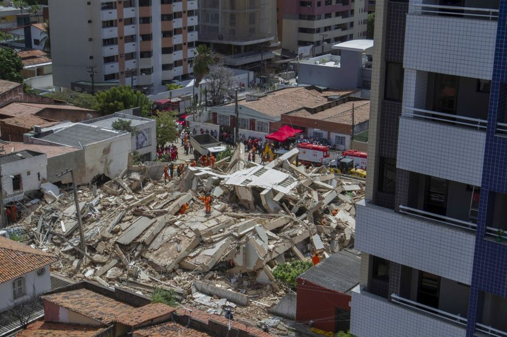 Aerial view of firefighters searching for survivors among the rubble after a seven-floor residential building collapsed in Fortaleza, Ceara state, Brazil, on October 15, 2019. — AFP pic
