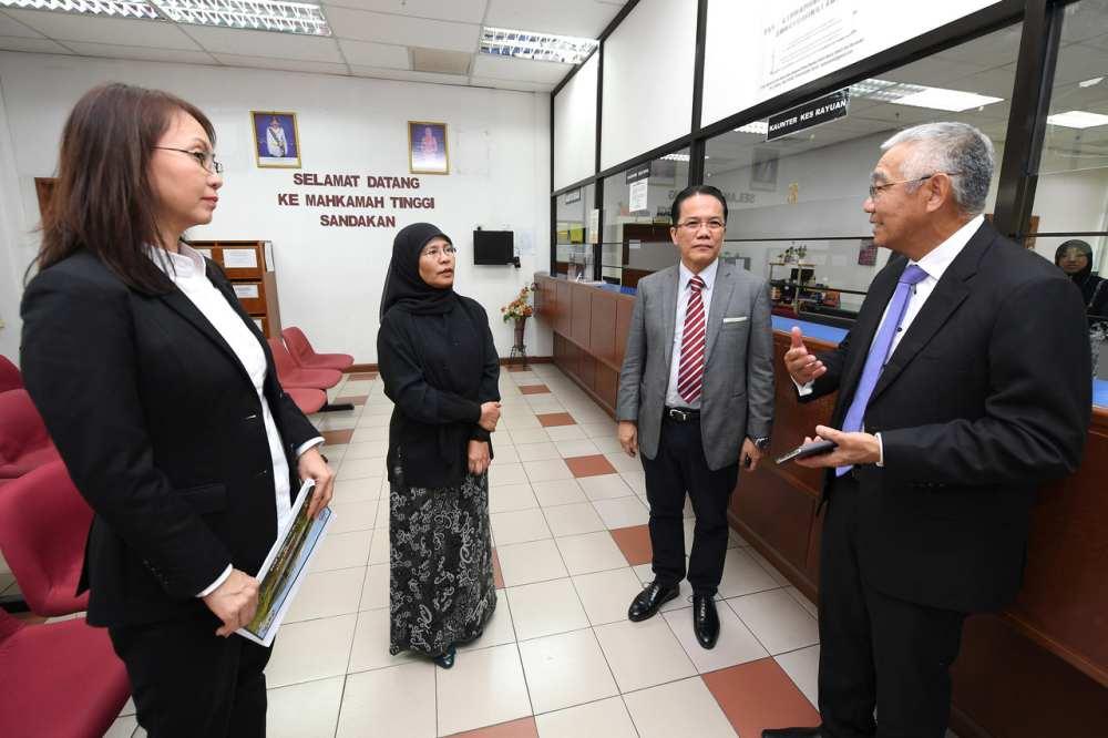 Chief Justice Tan Sri Tengku Maimun Tuan Mat (second left) at the the Sandakan Court today, October 21, 2019. ― Bernama pic