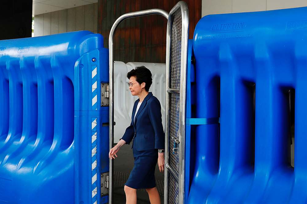 Hong Kong Chief Executive Carrie Lam walks past a barrier to meet petitioners before a weekly Executive Council meeting in Hong Kong October 8, 2019. — Reuters pic