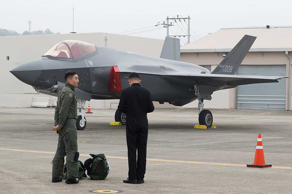 A South Korean fighter pilot (left) stands next to his F-35 stealth fighter during a ceremony to mark the 71st Armed Forces Day at the Air Force Base in Daegu October 1, 2019. — Jeon Heon-kyun/Pool pic via Reuters