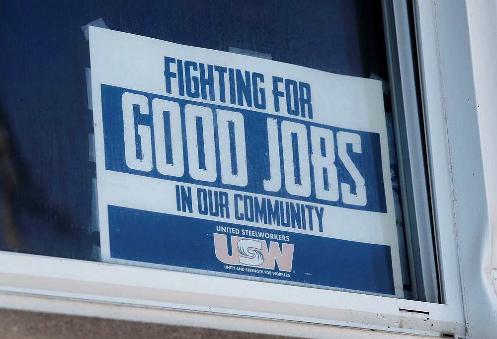 A 'Fighting For Good Jobs' sign is seen in the window of Steelworkers Local 1299 union hall in Ecorse, Michigan September 24, 2019. — Reuters pic