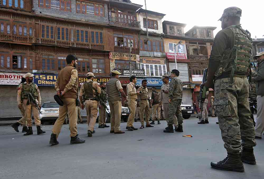 Indian police officers stand at the site of a grenade attack in Srinagar October 12, 2019. — Reuters pic