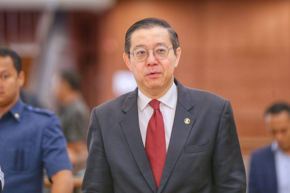 Finance Minister Lim Guan Eng is pictured at the Parliament lobby, October 15, 2019. According to the bill, tabled by Lim, the amendment is effective for the year of assessment 2020 and subsequent years. — Picture by Ahmad Zamzahuri
