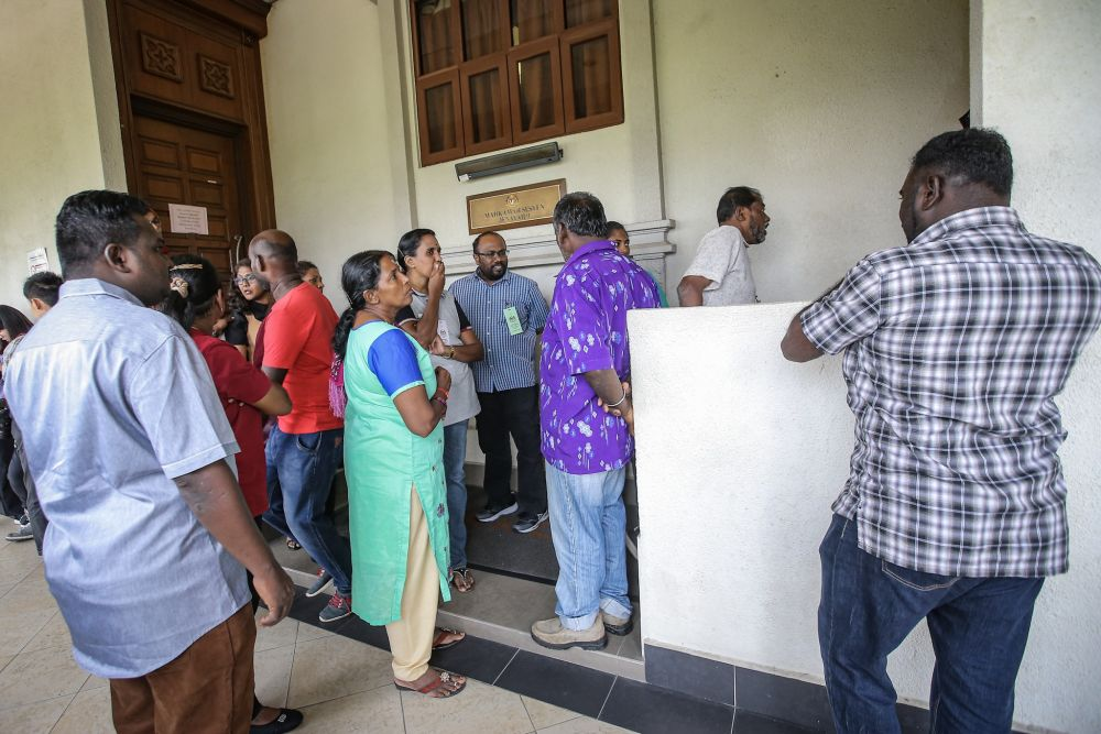 Family members of suspected Liberation Tigers of Tamil Eelam sympathisers are pictured outside a courtroom at the Kuala High Court October 31, 2019. — Picture by Hari Anggara