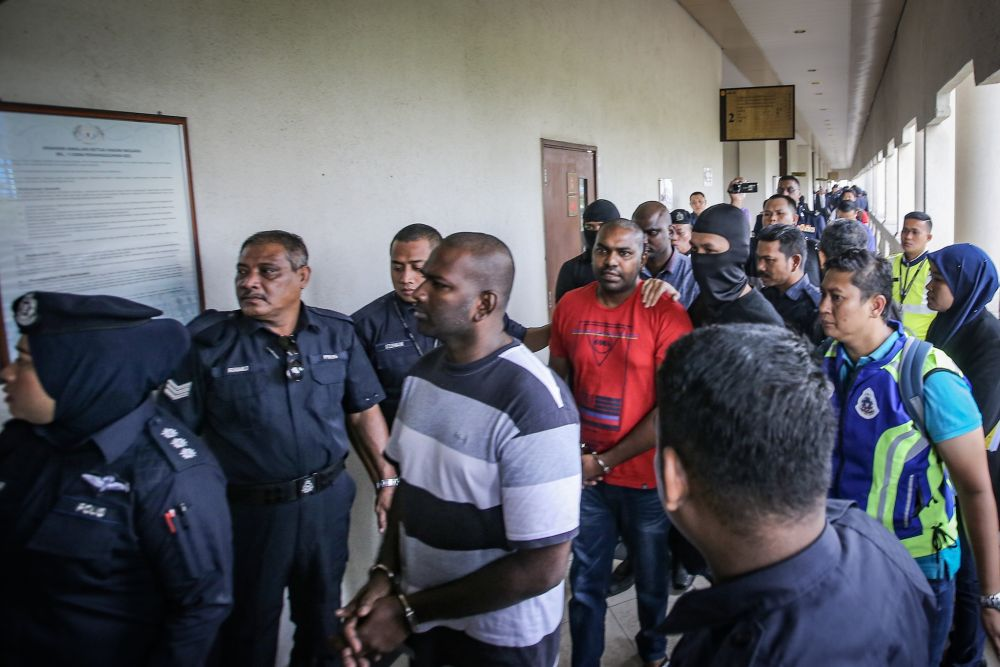 Suspected Liberation Tigers of Tamil Eelam sympathisers are escorted to the Kuala Lumpur High Court October 31, 2019. — Picture by Hari Anggara