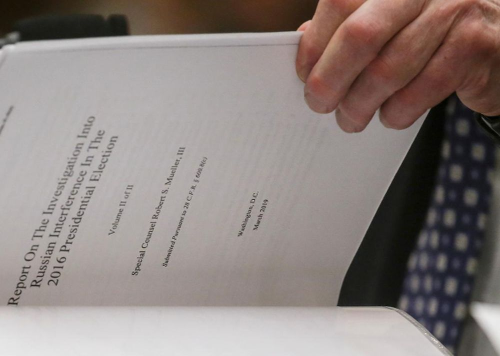Former Special Counsel Robert Mueller references a copy of his report as he testifies before a House Judiciary Committee hearing on the investigation into Russian Interference in the 2016 Presidential Election, July 24, 2019. — Reuters pic