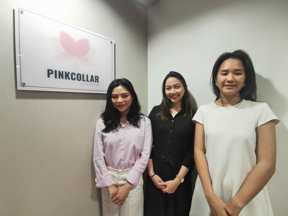The founding team of Pinkcollar, which billed itself as Malaysia's first ethical recruitment agency aimed at tackling debt bondage among migrant domestic workers, pose for a photo at its office in Kuala Lumpur October 3, 2019. — Reuters pic