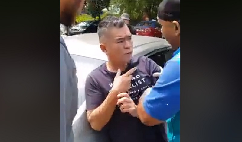 MPSJ council workers confront Koh after her persistently tried to stop them from capturing 'Puchong.' — Screengrab via Facebook/We Are Malaysian