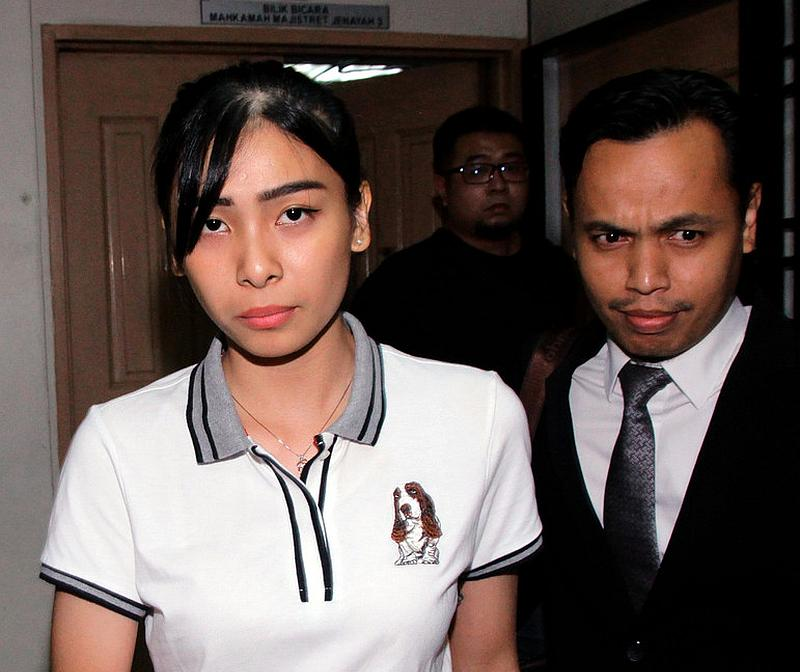 Sales promoter Sam Ke Ting (left), 24, was released by the Johor Bahru Magistrate Court October 28, 2019. She was cleared of reckless driving that led to the death of eight teenage cyclists on January 18, 2017. — Bernama pic