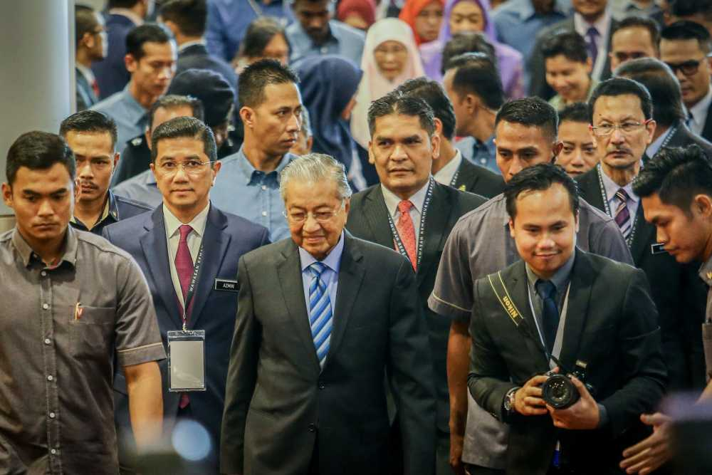 Prime Minister Tun Dr Mahathir Mohamad (centre) arrives at the launch of Shared Prosperity Vision 2030 in Kuala Lumpur October 5, 2019. ― Picture by Hari Anggara