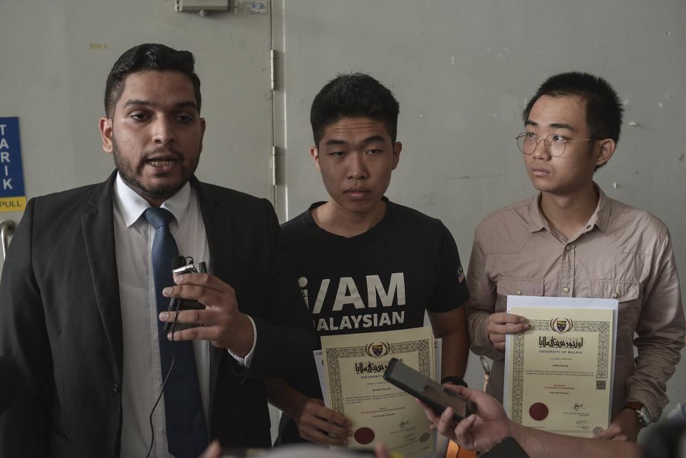 (From left) Legal representative Asheeq Ali, student activist Wong Yan Ke and Edan Kon speak during a press conference outside University of Malaya's examination hall in Kuala Lumpur October 19, 2019. ― Picture by Shafwan Zaidon