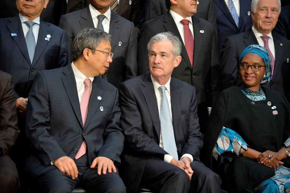 People's Bank of China Governor Yi Gang, Federal Reserve Chairman Jerome Powell gather for a group photo during the IMF and World Bank's 2019 Annual Meetings of finance ministers and bank governors, in Washington, US, October 19, 2019. — Reuters pic