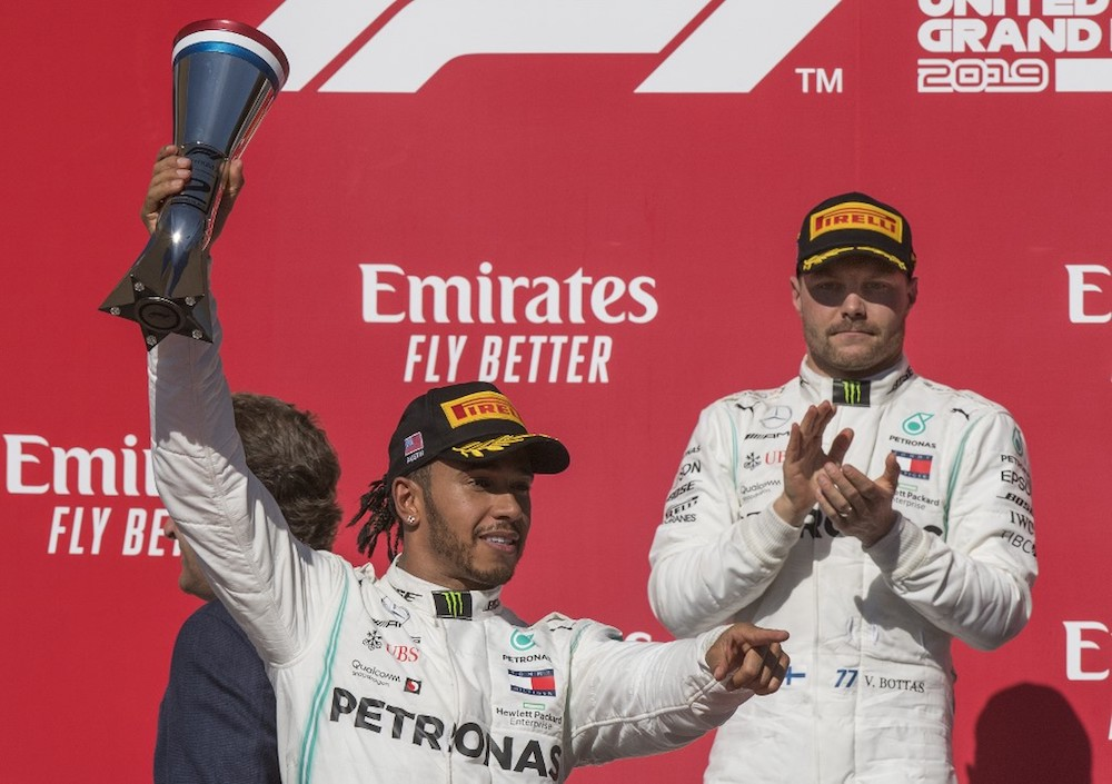 Lewis Hamilton of Great Britain with the Mercedes AMG Petronas F1 Team reacts after being crowned World Champion during his second-place finish, beside winner and teammate Valtteri Bottas, at the United States Grand Prix November 3, 2019. — AFP pic