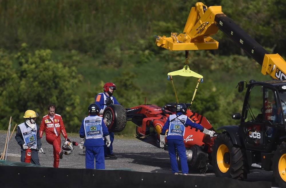 Ferrari's Sebastian Vettel reacts while a crane lifts his car after a crash during the Brazilian Grand Prix at the Interlagos racetrack in Sao Paulo November 17, 2019. — AFP pic