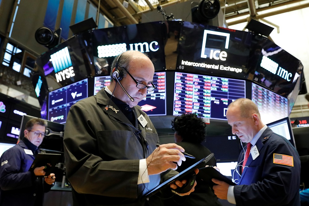 Trader work on the floor at the New York Stock Exchange November 18, 2019. — Reuters pic