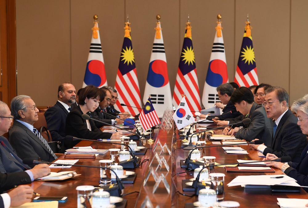 Prime Minister Tun Dr Mahathir Mohamad listens to South Korean President Moon Jae-in during their summit at the Presidential Blue House in Seoul November 28, 2019. — Reuters pic