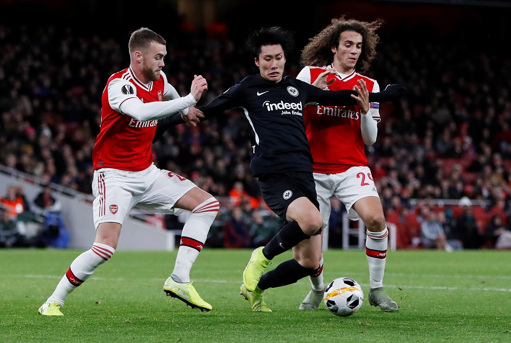 Eintracht Frankfurt's Daichi Kamada in action with Arsenal's Matteo Guendouzi at the Emirates Stadium in London November 28, 2019. — Action Images via Reuters