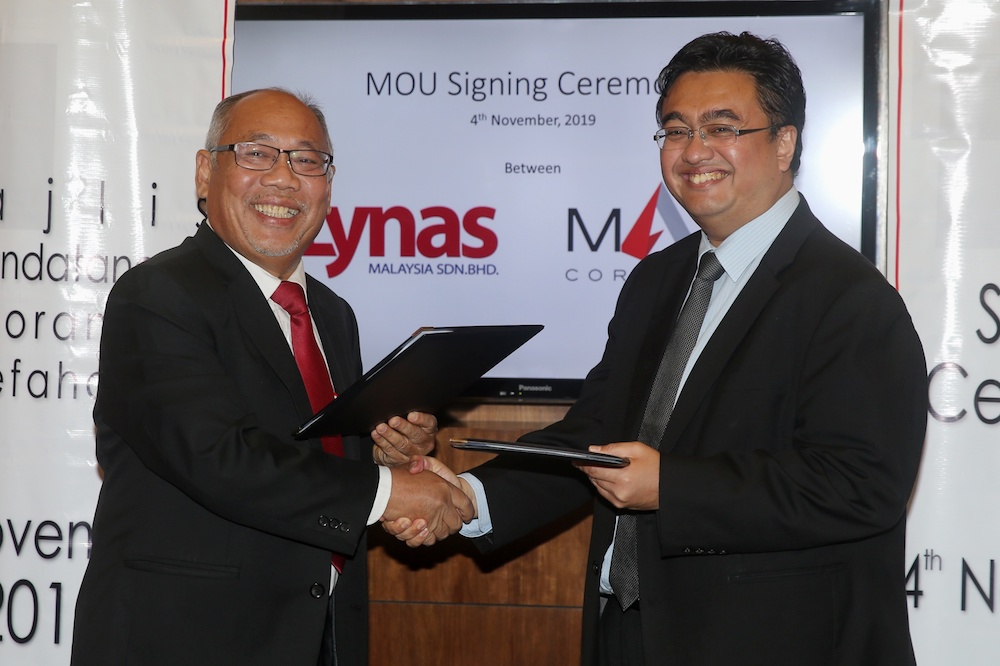 Akhramsyah Muammar Ubaidah Sanusi shakes hands with Datuk Mashal Ahmad after signing an MoU between MARA Corporation and Lynas Malaysia in Kuala Lumpur November 4, 2019. — Picture by Choo Choy May