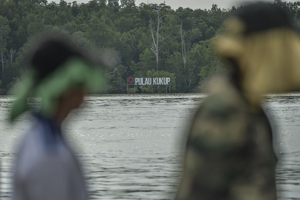 A Pulau Kukup sign on a mangrove island is seen from Kampung Air Masin in Kukup November 3, 2019. — Picture by Shafwan Zaidon