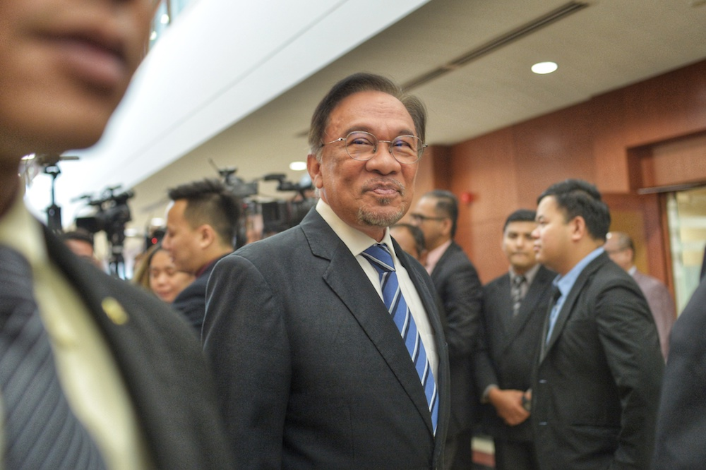 Datuk Seri Anwar Ibrahim leaves after speaking to reporters at the Parliament building in Kuala Lumpur November 20, 2019. — Picture by Shafwan Zaidon