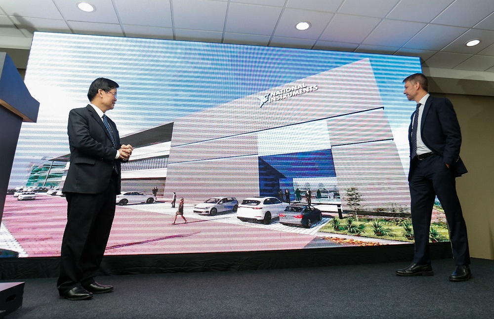 Penang Chief Minister Chow Kon Yeow (left) and National Instruments president and COO Eric Starkloff (right) viewing a montage during the official site opening of the company's new expanded unit in Batu Maung November 21, 2019. — Picture by Sayuti Zainudin