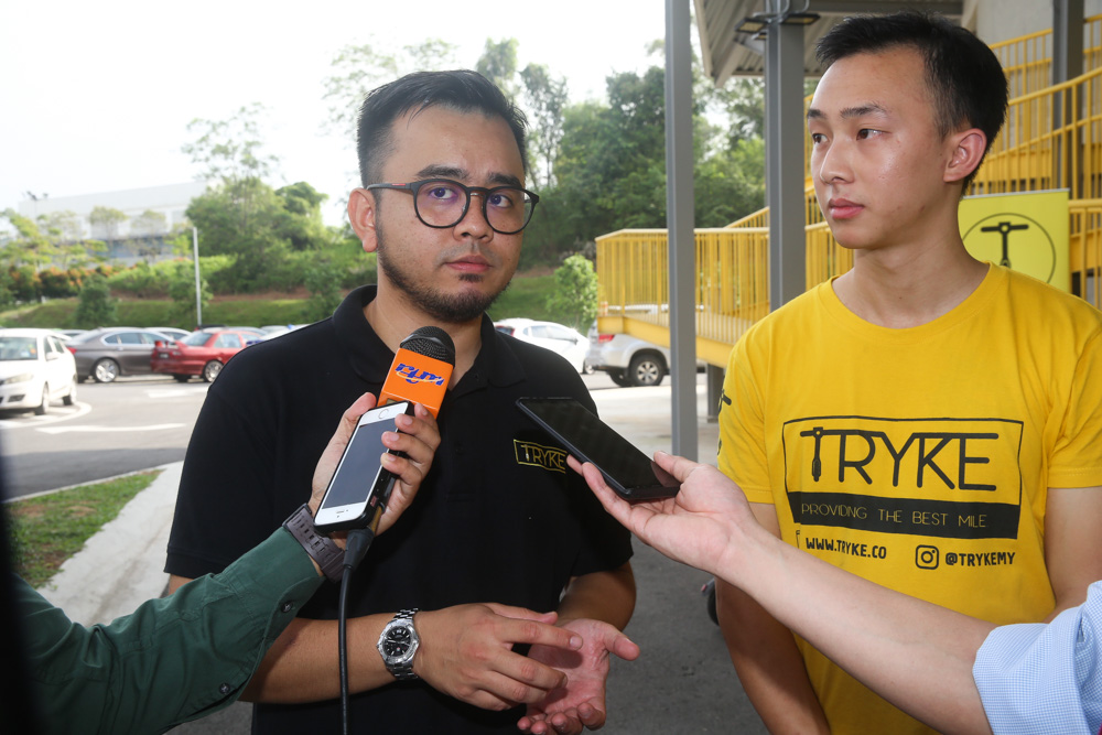 E-scooter sharing service Tryke's co-founder Shazwan Abdul Razak (left) and founder Timothy Wong speak to reporters at RekaScape in Cyberjaya November 22, 2019.