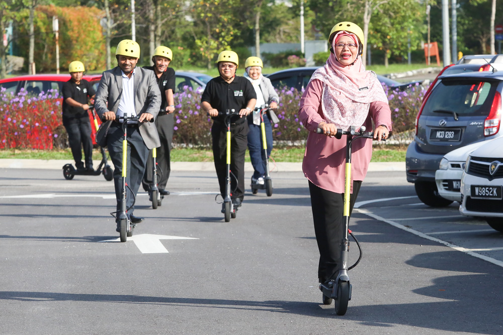People try out the Tryke e-scooters during its soft launch at RekaScape in Cyberjaya November 22, 2019.