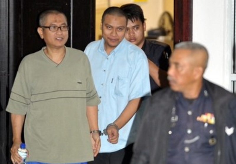 File picture showing terrorists Yazid Sufaat (left)  outside the Appeal Court in Putrajaya May 31, 2013. Police said Yazid would be restricted to Ampang here and must obtain police permission to leave the area.  — Bernama pic