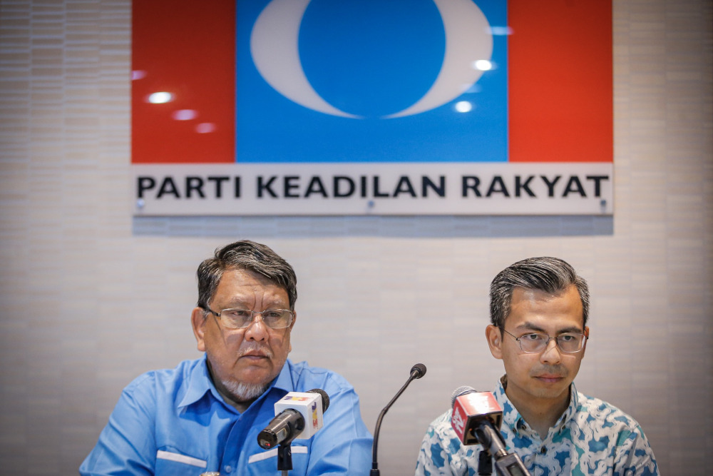 PKR Disciplinary Board chairman Datuk Ahmad Kasim and PKR communications director Fahmi Fadzil are seen during the press conference at PKR headquarters in Damansara on November 24, 2019. — Picture by Hari Anggara